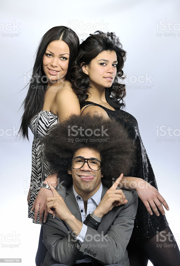 funky man pointing at two attractive women stock photo