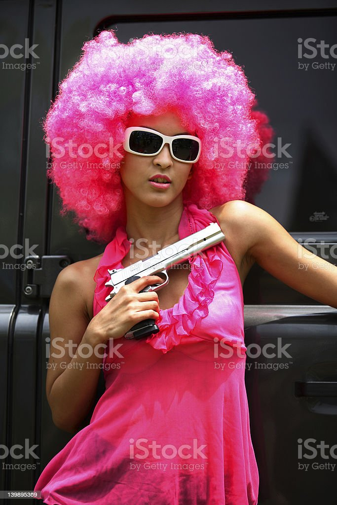 Funky Woman with a gun royalty-free stock photo