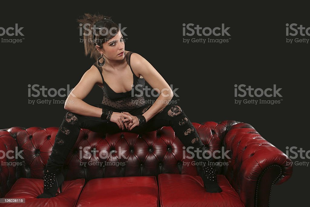 Funky young woman on a sofa stock photo