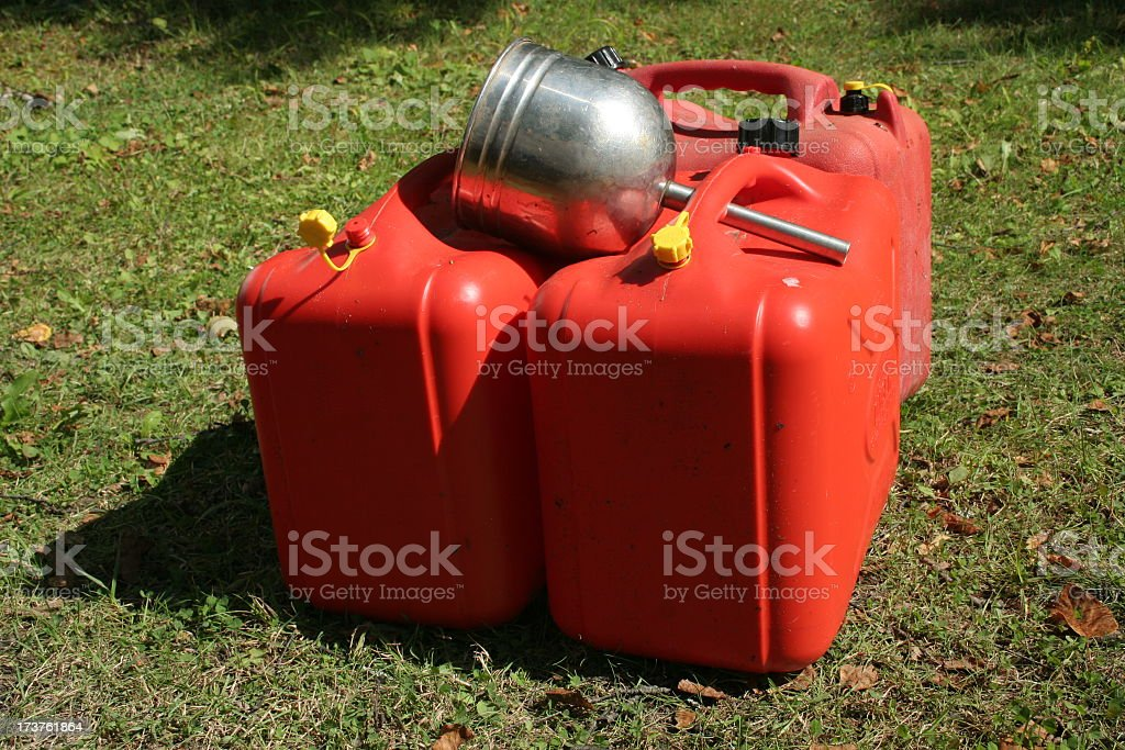 Funnel and Gas Cans stock photo