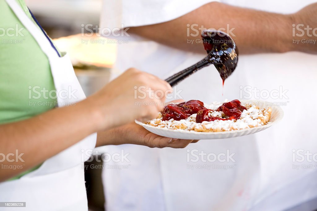 Funnel Cake with Strawberry Topping at Carnival royalty-free stock photo