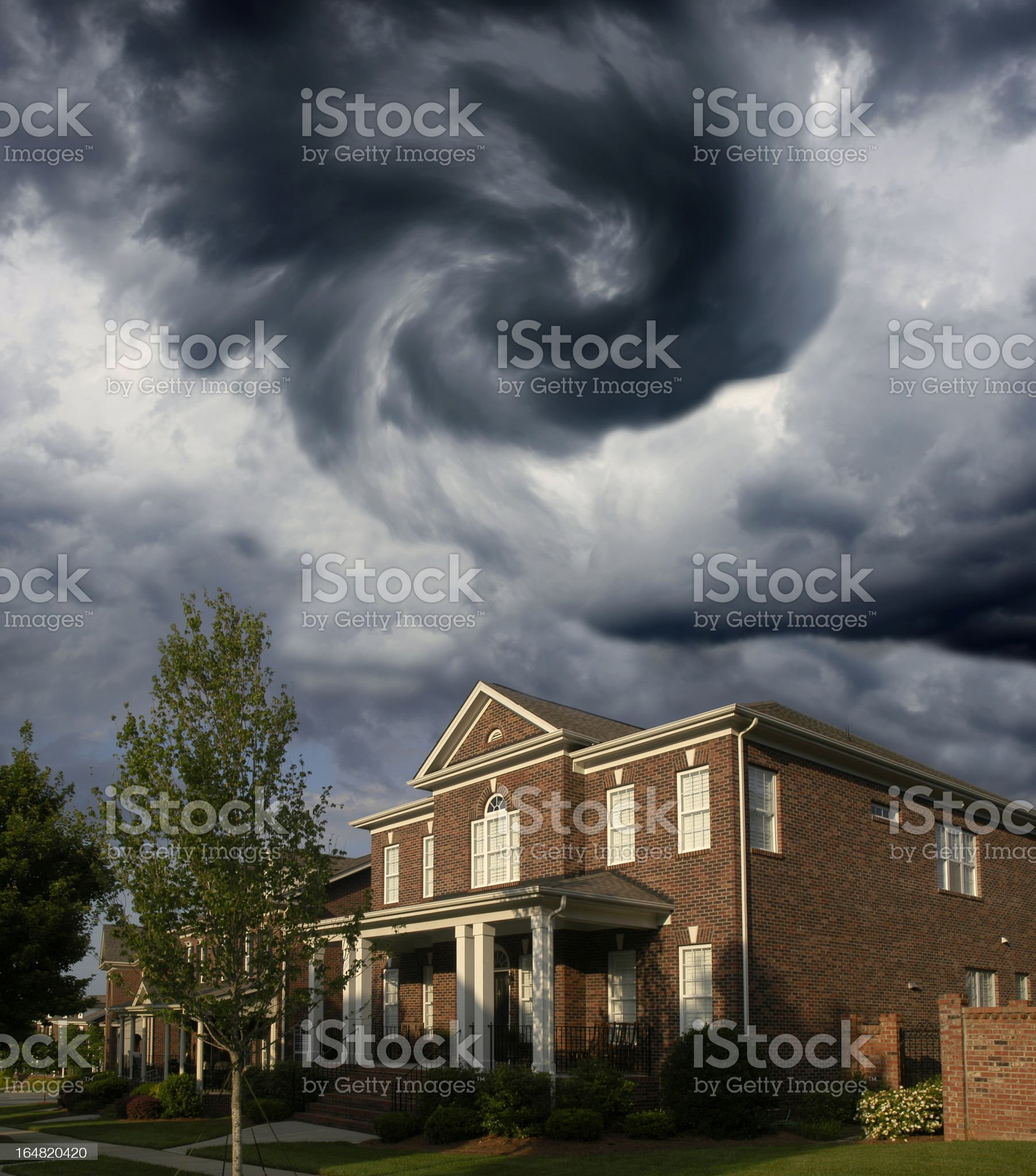 Funnel Cloud Over a Row of Brick Homes royalty-free stock photo