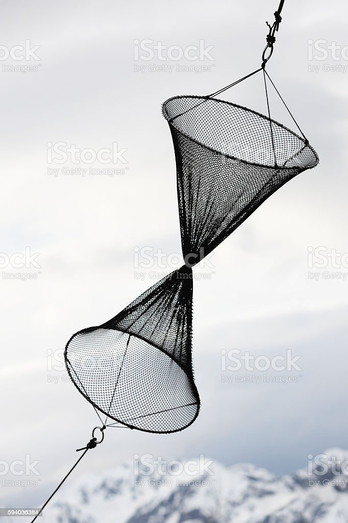 Funnel Drum Net Fish Trap stock photo