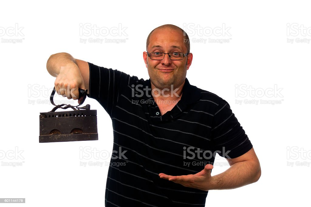 Funny amazed man in glasses and causial shirt holding old stock photo