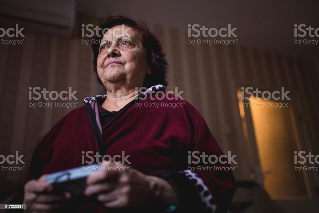 Funny angry old grandma playing games stock photo