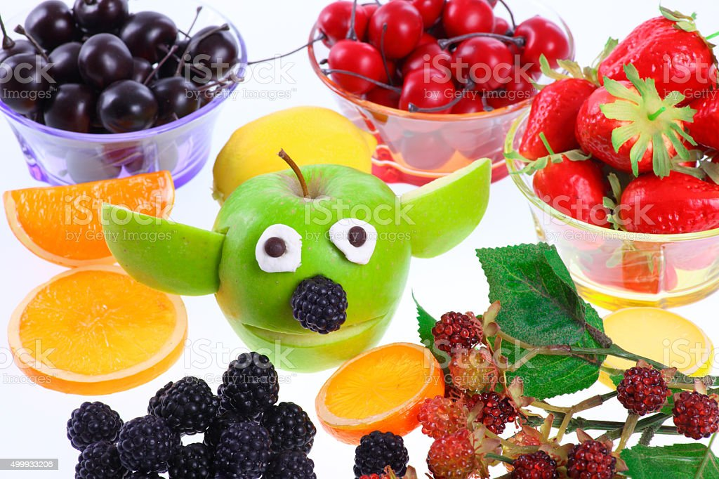 Funny apple figure with deco fruits stock photo