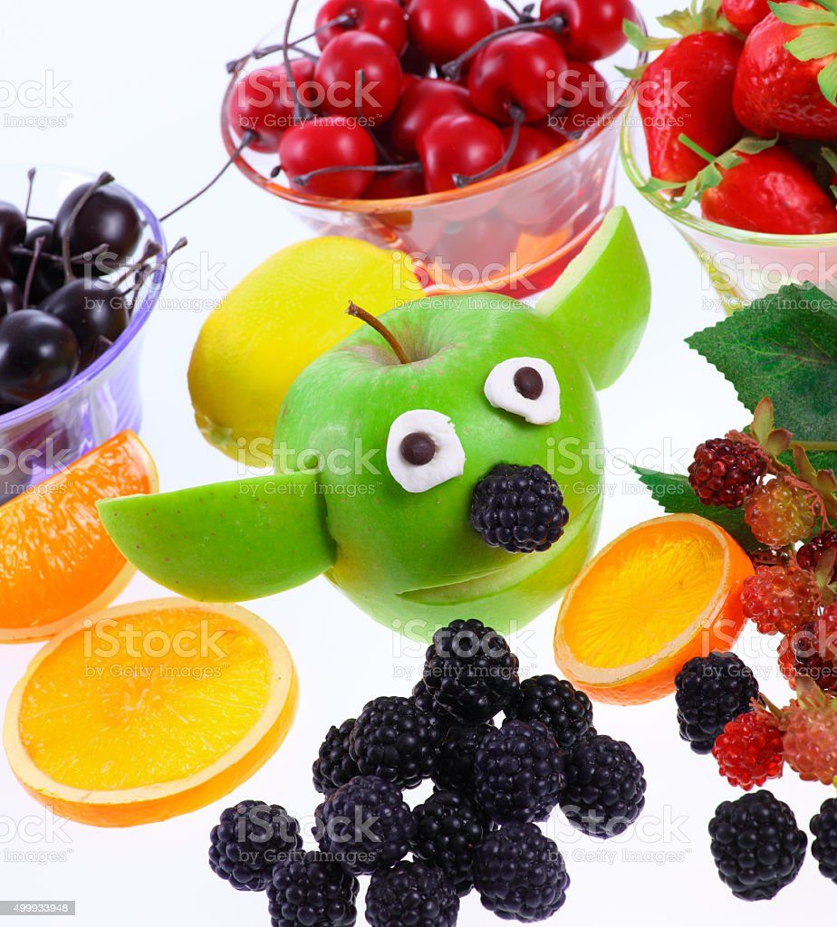 Funny Apple with dekoration fruits stock photo