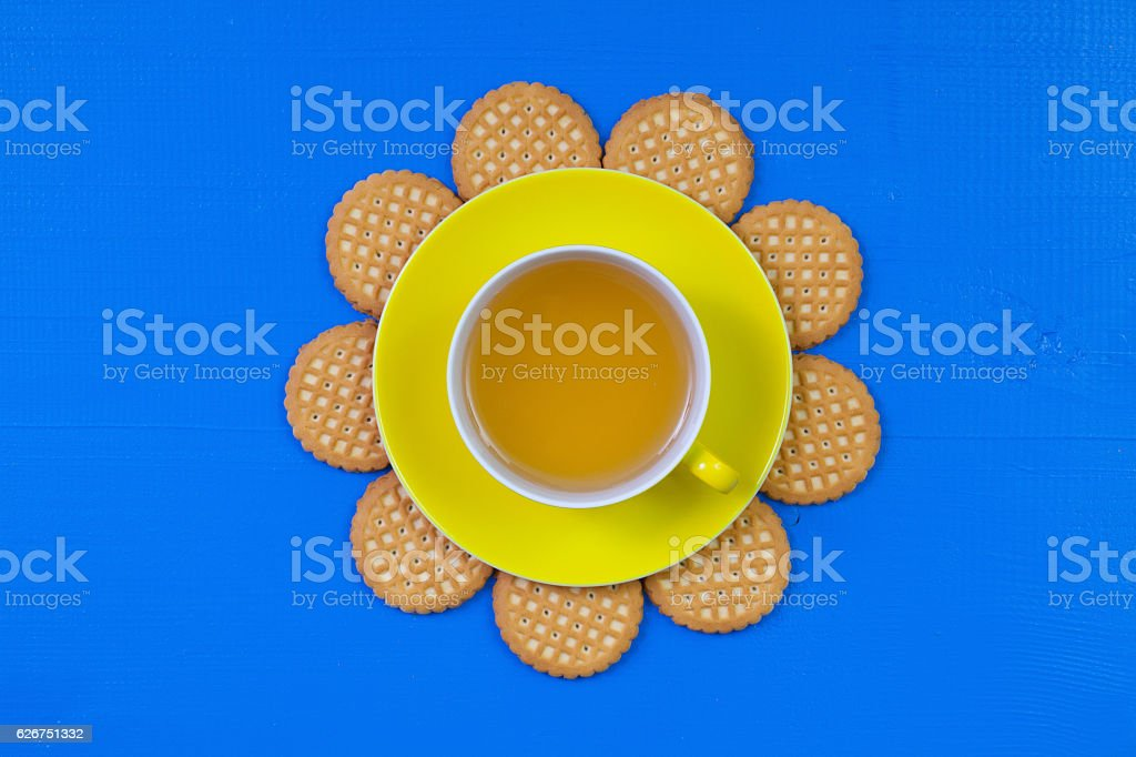 Funny arrangement  cup of tea on blue wooden table stock photo