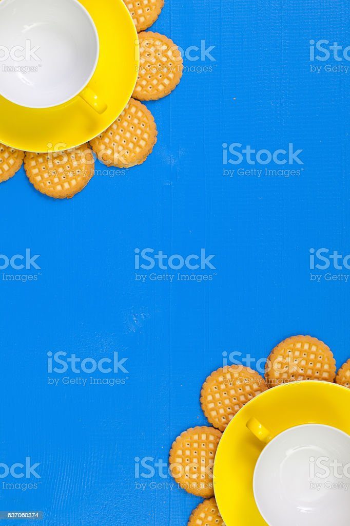 Funny arrangement  empty cups of tea on blue wooden table stock photo