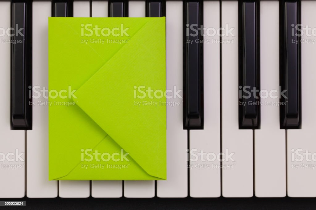 Funny arrangement envelope on the piano keybords stock photo
