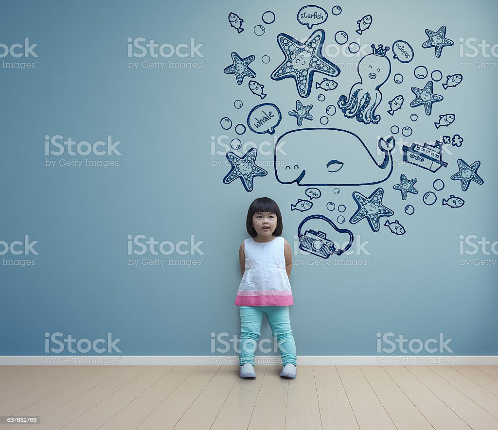 Funny asian child playing in blue room at home stock photo