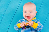 Funny baby boy on blue knitted blanket