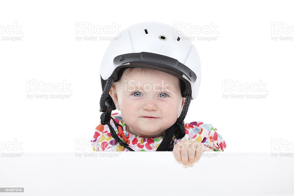 funny baby girl with bicycle helmet royalty-free stock photo