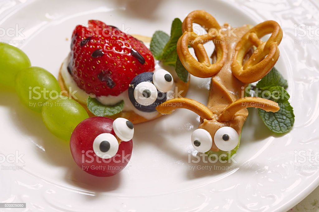 Funny beetles from grapes and berries stock photo