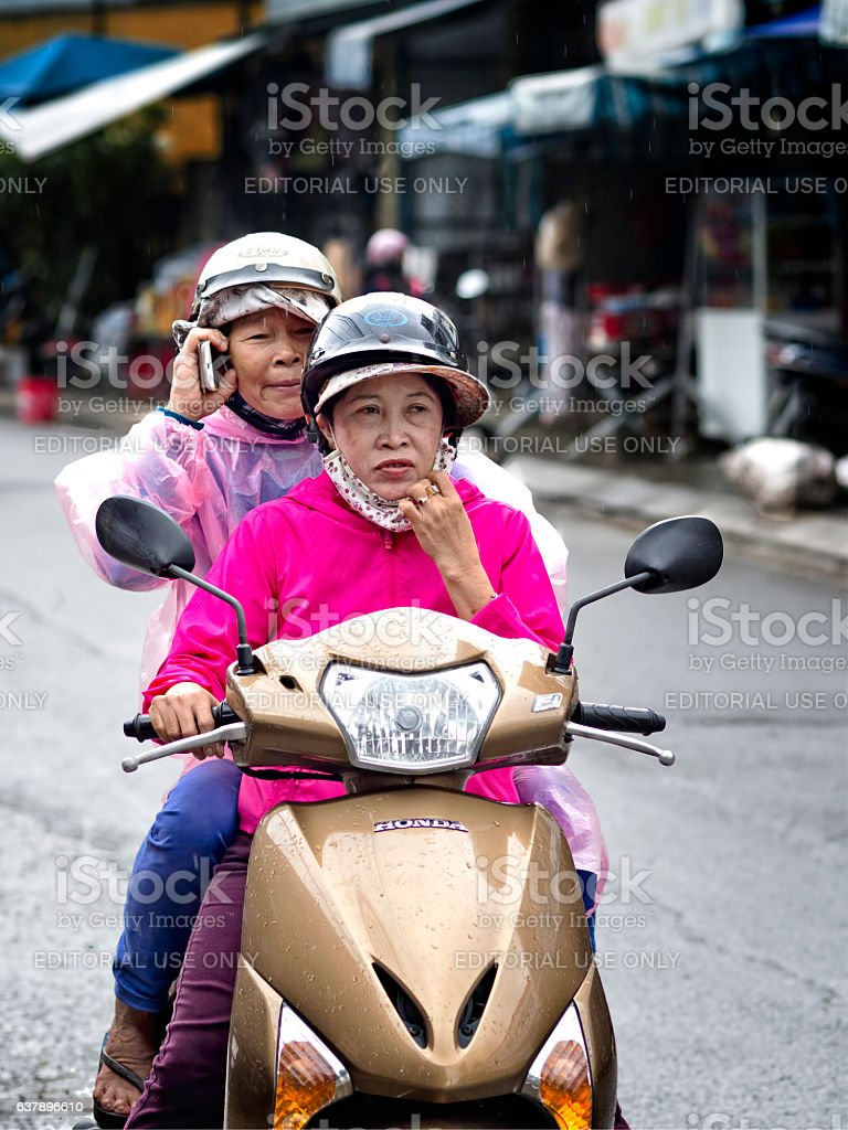 Funny biker with pillion in Hoi An stock photo