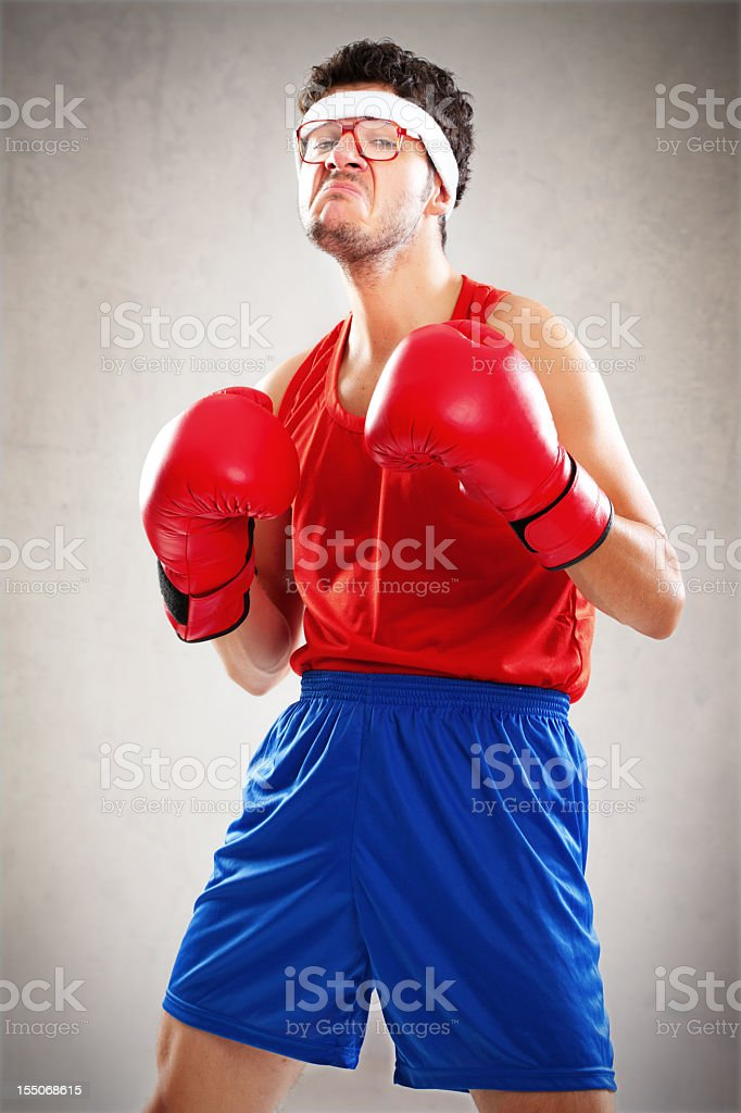 Funny boxer with bad attitude posing over brown background royalty-free stock photo