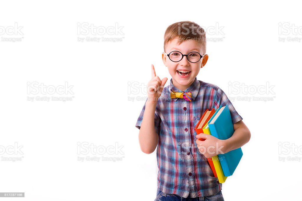 funny boy five years with books on a white background stock photo