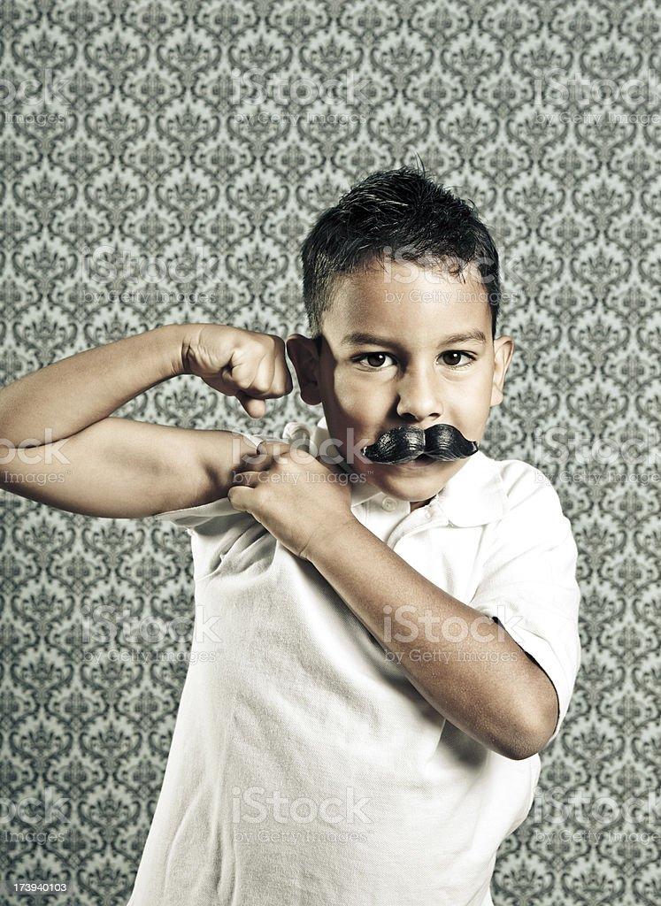 funny boy flexing royalty-free stock photo