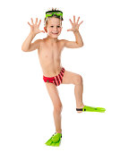Funny boy in diving mask and flippers