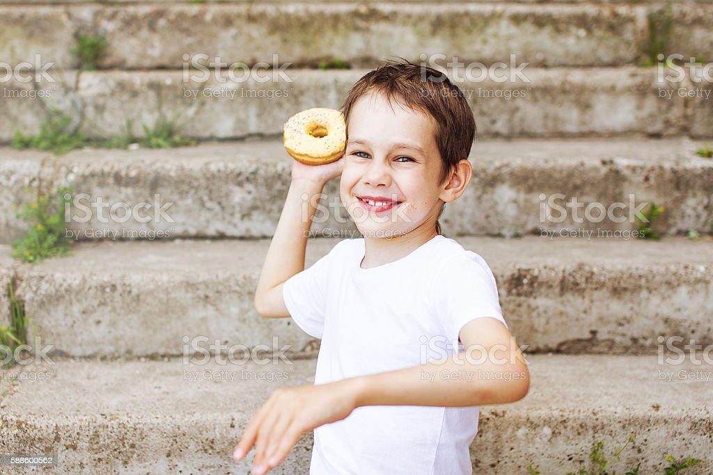 funny boy playing in the fight donuts stock photo