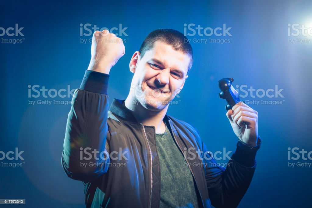 Funny boy, playing video games, he is focused in game stock photo