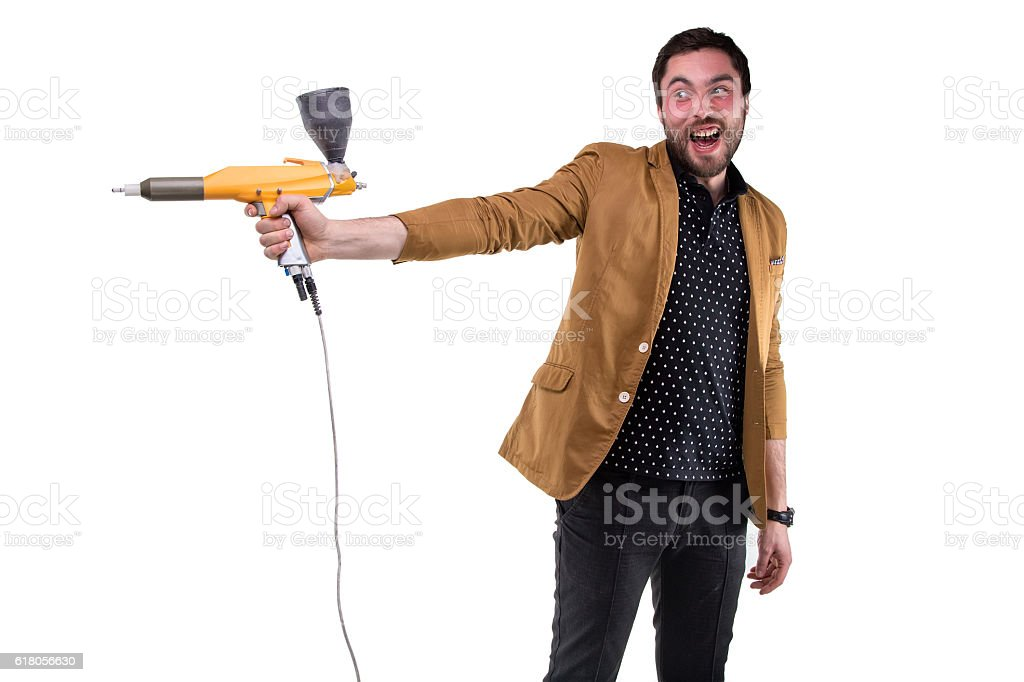 Funny brunette man with powder gun stock photo