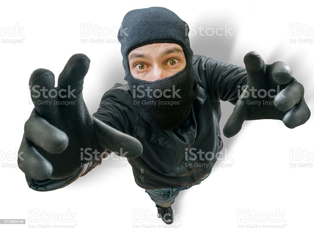 Funny burglar is stretching towards camera filming him from top. stock photo