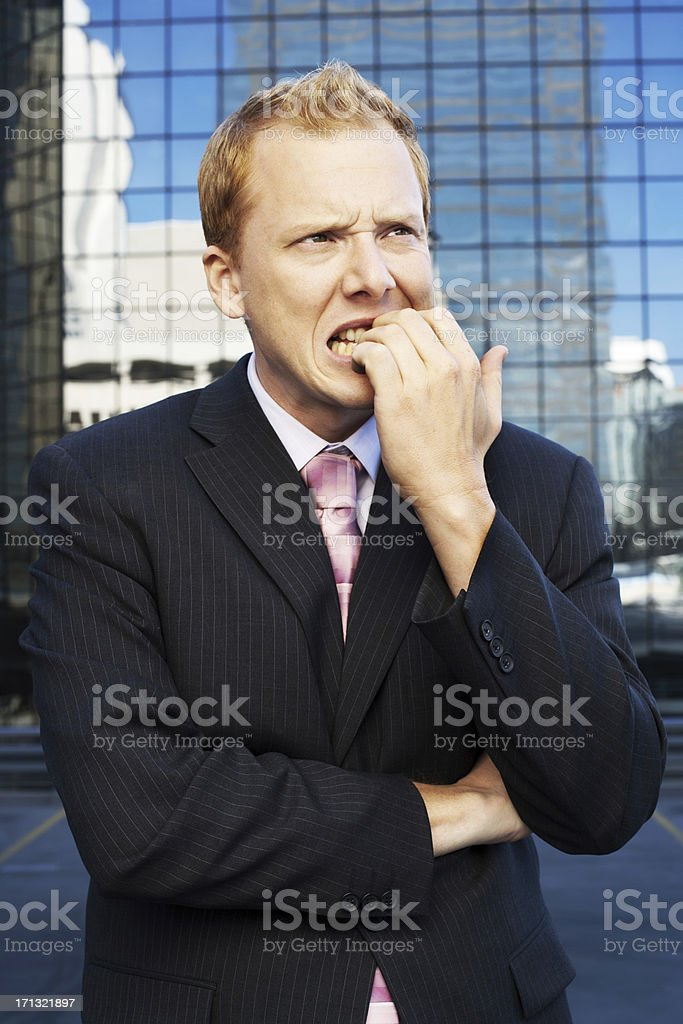 funny businessman bites his nails on roof royalty-free stock photo
