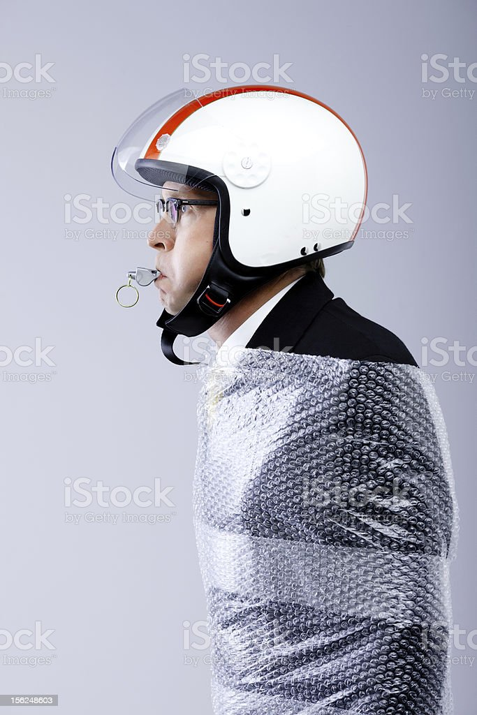 funny businessman blows the whistle stock photo