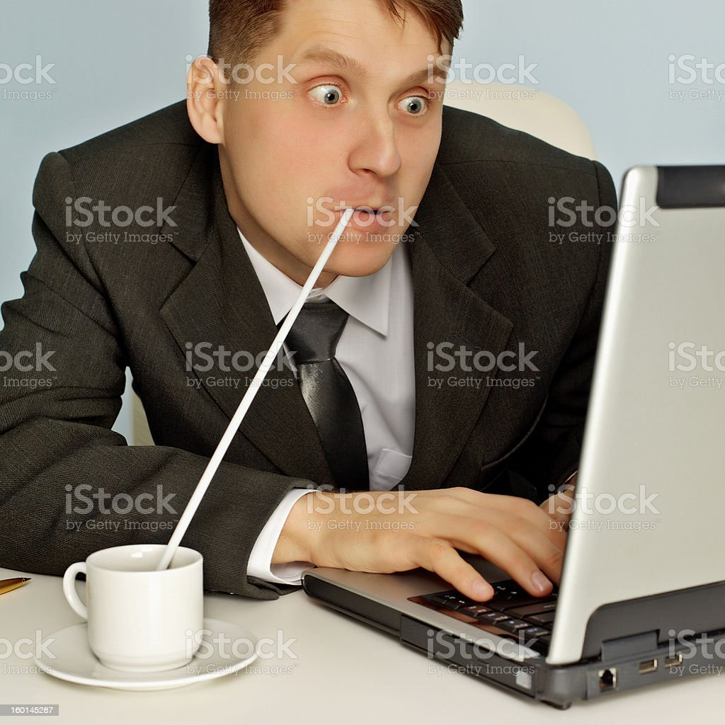 Funny businessman drinking coffee and working royalty-free stock photo