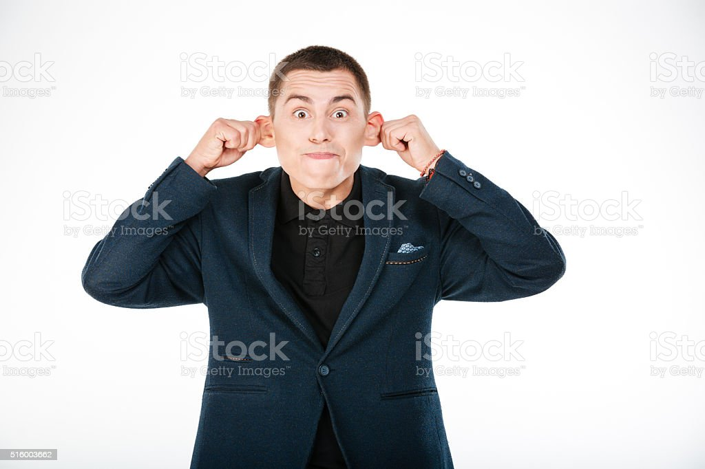 Funny businessman holding his ears stock photo