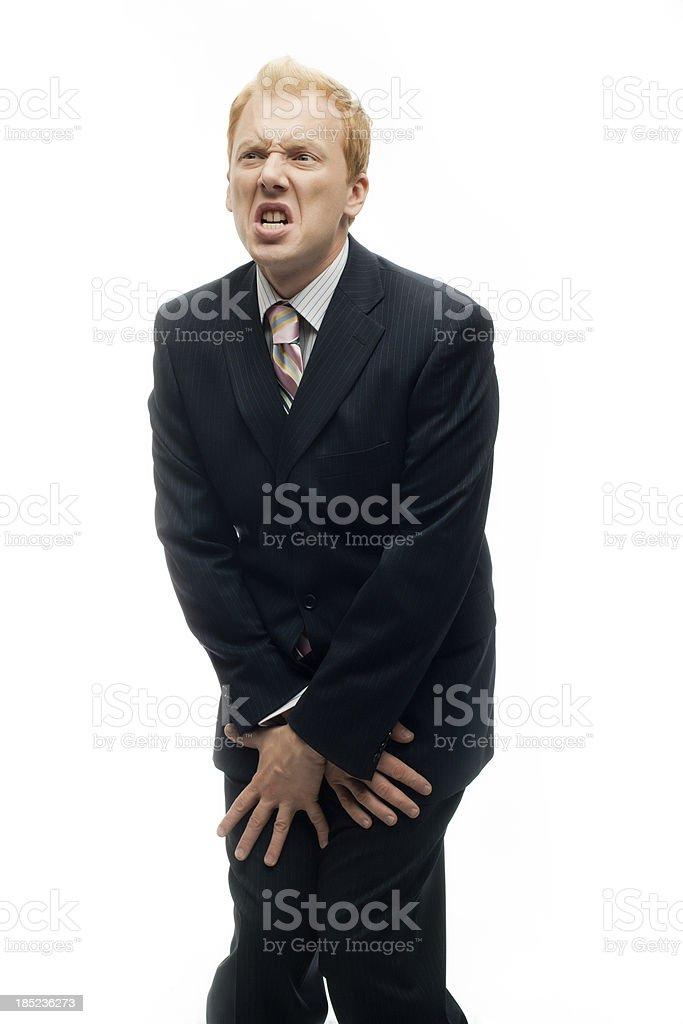 Funny Businessman keeps his bollocks safe on White stock photo