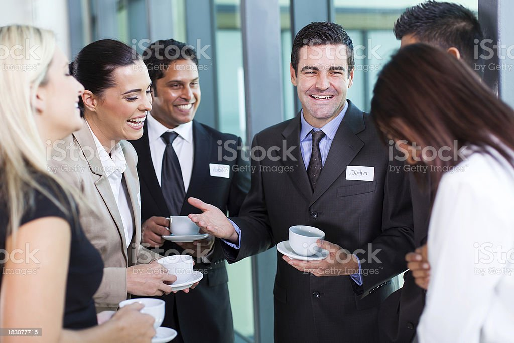 funny businessman telling a joke stock photo