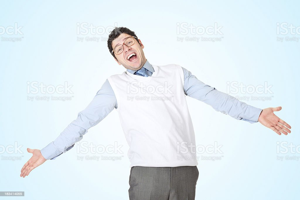 Funny businessman with his arms outstreched over blue background stock photo