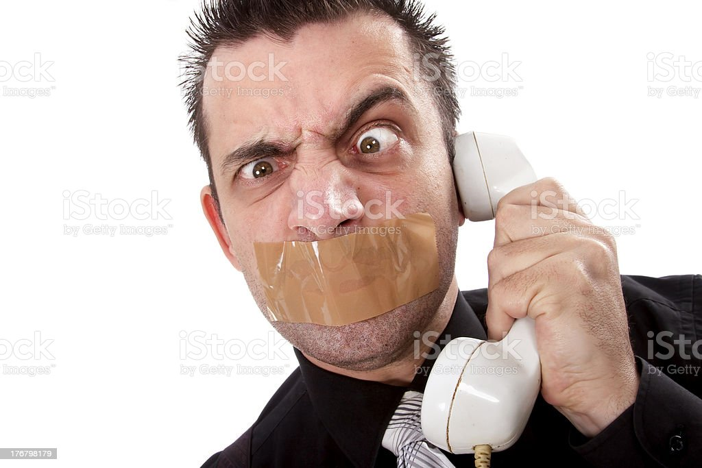 Funny businessman with tape on his mouth royalty-free stock photo