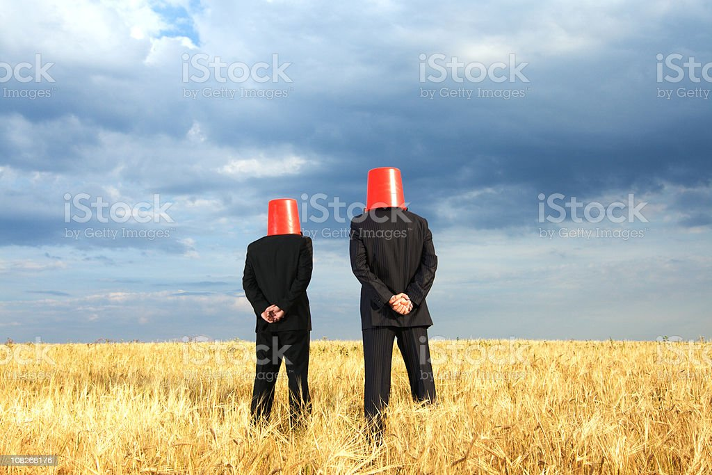 Funny businessmen with buckets royalty-free stock photo