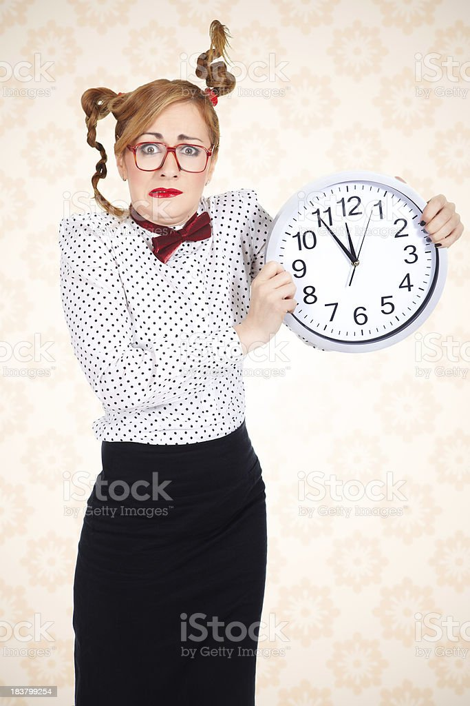 Funny businesswoman holding big clock and making funny face royalty-free stock photo