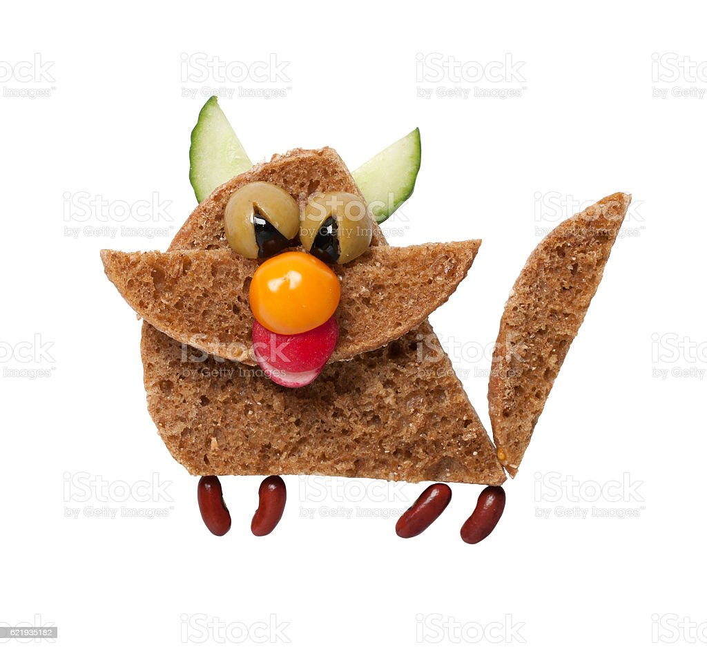 Funny cat made of black bread on white background stock photo