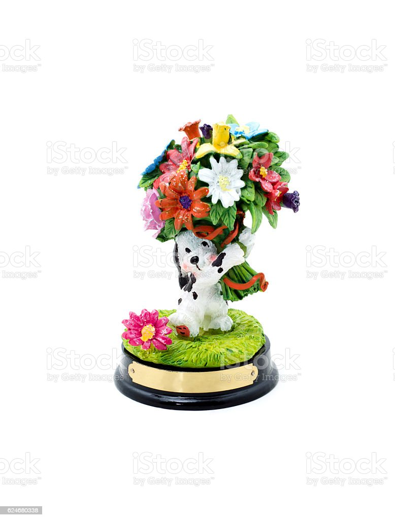 Funny ceramic dog with flowers on a white background. stock photo