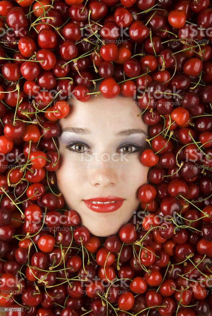 Funny Cherry Girl stock photo