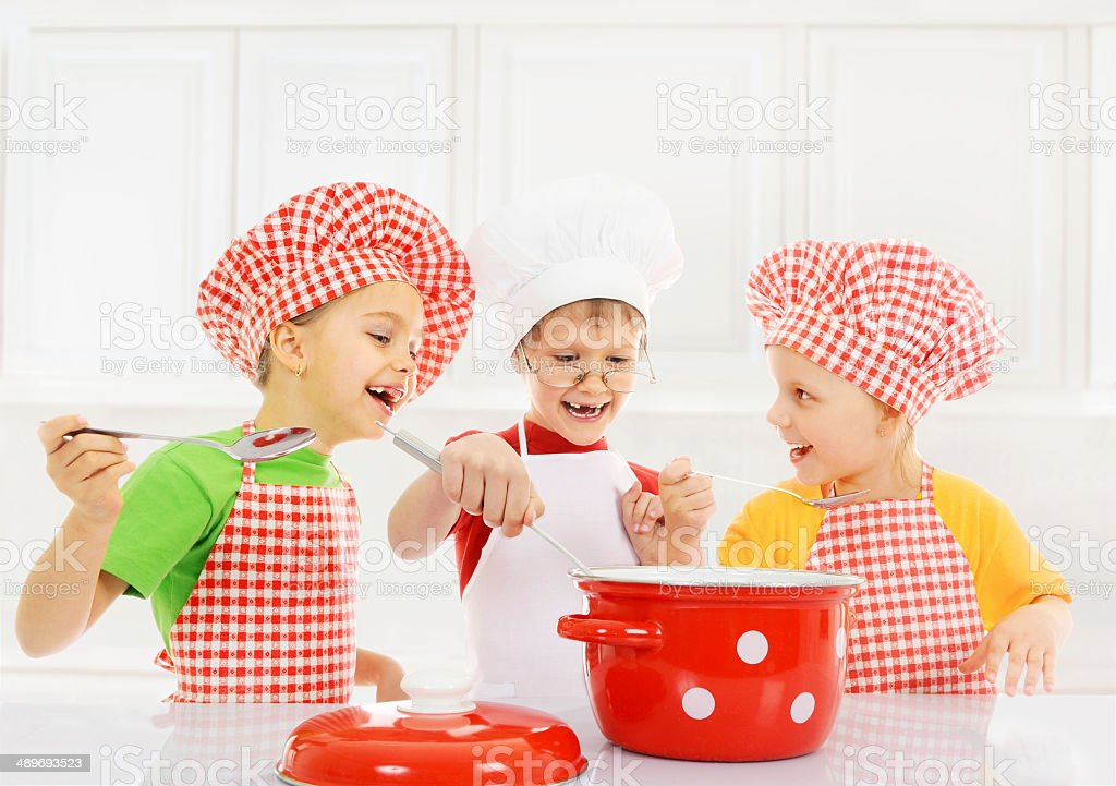 Funny children cooking stock photo