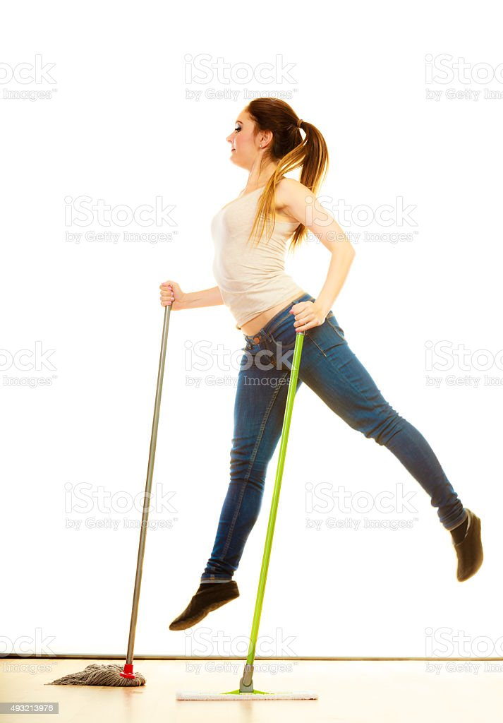 Funny cleaning woman mopping floor jumping stock photo