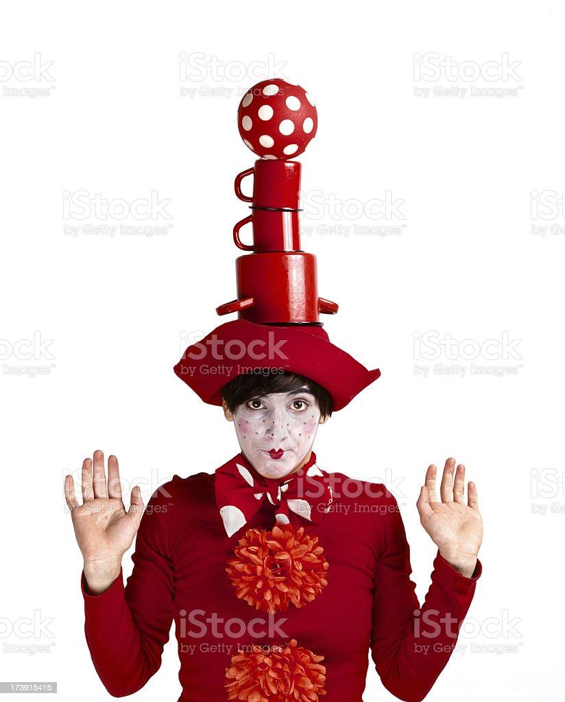 Funny clown balancing pots and a ball stock photo