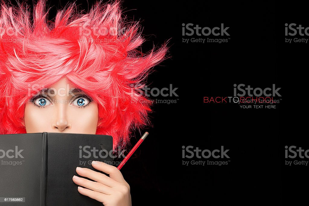 Funny College Girl Covering her Face with Black Notebook stock photo