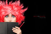 Funny College Girl Covering her Face with Black Notebook