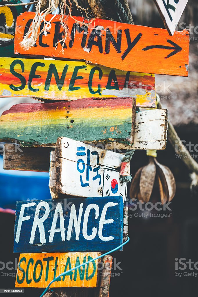 Funny colorful signpost to different countries around the world stock photo