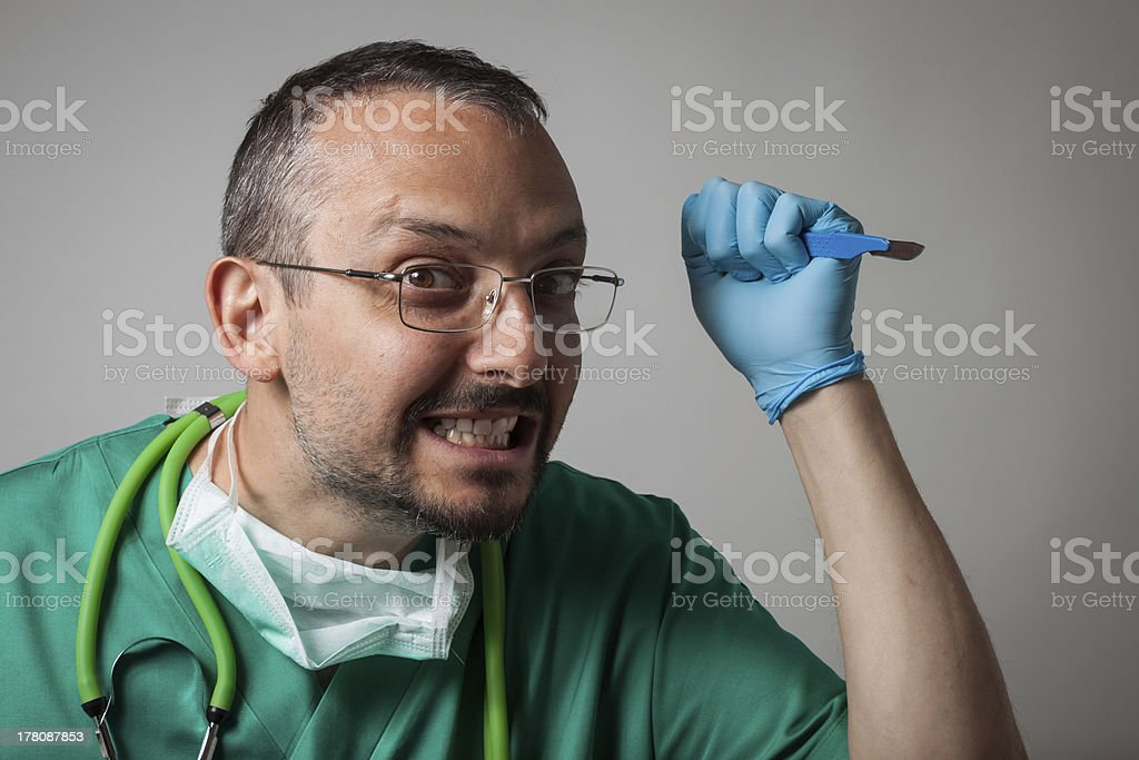 Funny crazy doctor holding a surgical knife royalty-free stock photo
