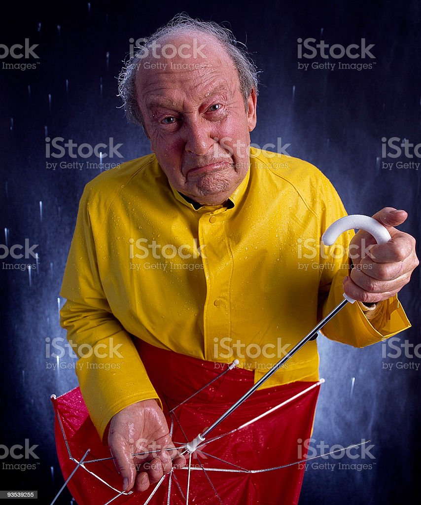 funny crying man with broken umbrella is soaked and miserable. royalty-free stock photo