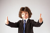 Funny curly boy with gesture with two hands, 'very good'