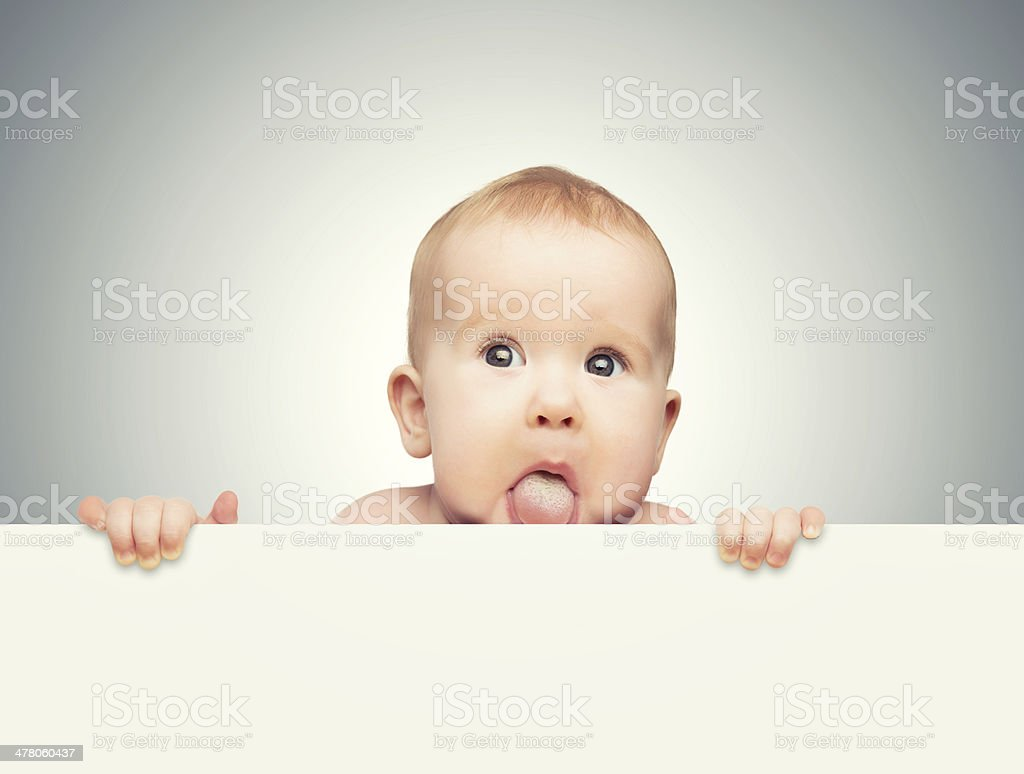 funny cute baby with white blank banner stock photo
